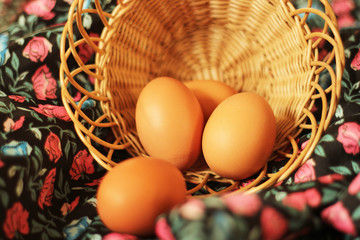 eggs and basket on floral background
