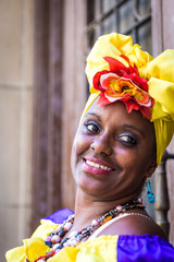 Portrait of african cuban woman looking at camera and smiling