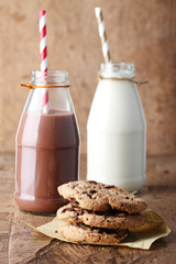 Fresh milk with drinking straw and cookies