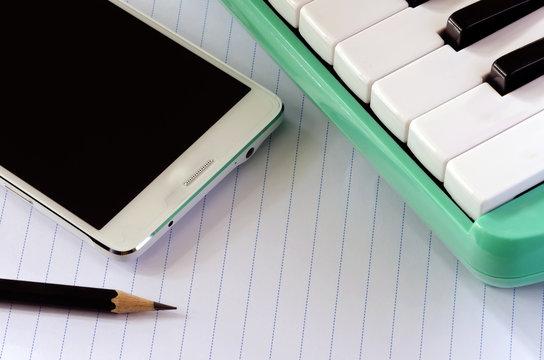 Smartphone melodica and pencil