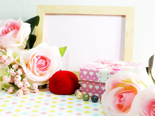 blank photo wood frame with pink roses and gift box on sweet flower