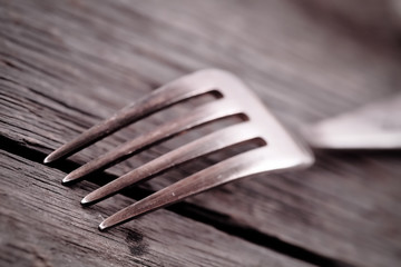 Fork on the wood background