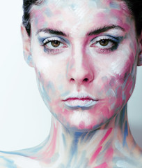 young woman with creative make up like painted oil picture on