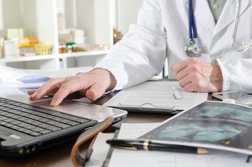 Doctor using a laptop