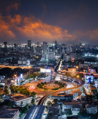 Bangkok city night view with main traffic high way.