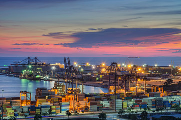 Fototapete - Container Cargo freight ship with working crane bridge in shipyard at dusk for Logistic Import Export background