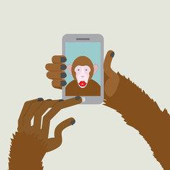 Monkey makes selfie. Animal clicks to your Smartphone with your