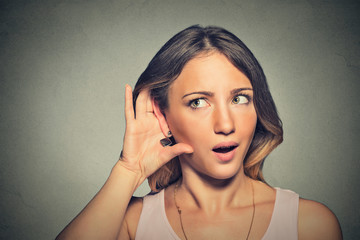 surprised nosy woman hand to ear gesture carefully secretly listening