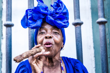 Cuban woman smoking in Havana, Cuba