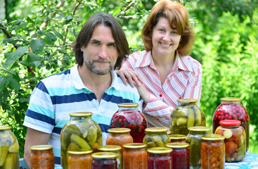 couple of middle age with homemade preserves and jams