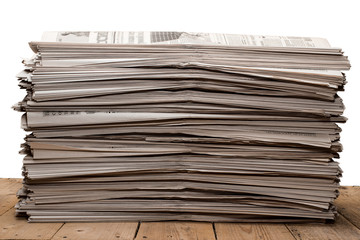 A stack of old newspapers on white background