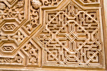 Carving on a wall in Alhambra