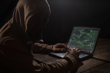 Silhouette of a hacker with laptop