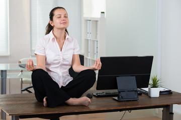Businesswoman Doing Meditation