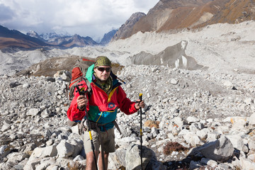 Backpacker crossing Ngozumpa glacier in Nepal.
