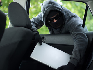 Car theft - a laptop being stolen through the window of an - fototapety na wymiar