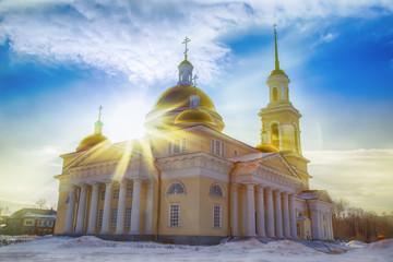 sun's rays shine through the dome of an Orthodox church