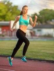Runner - woman running training.Female fitness concept