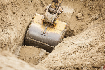 Excavator Tractor Digging A Trench