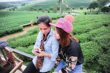 two asia beautiful Woman with telephon at tea farm