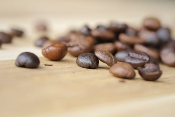 Close up Coffee bean on grunge wooden background