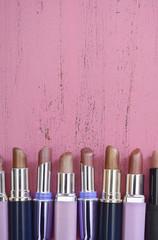 Makeup Items on Vintage Pink Wood Table