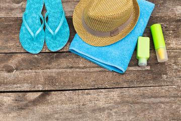 Summer beach essentials on old wooden background
