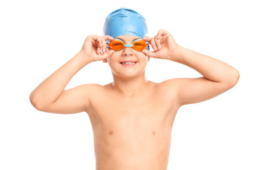 Little boy with swimming goggles and swim cap