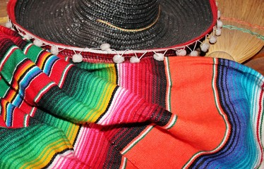 Mexican poncho sombrero poncho background Mexico with sombrero cinco de mayo background mexico fiesta copy space pattern stripes copy space serape stock photo photograph picture image