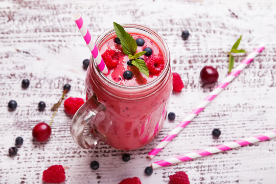Summer berries smoothie in a glass mug