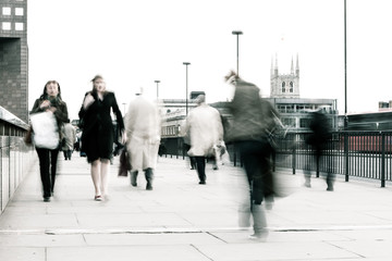 Bleached commuters. High key, abstract captures of business commuters during early morning London rush hour.  Long exposure creating a motion blur to emulate the movement of the scene.