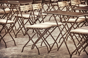 Retro styled image of restaurant chairs and tables