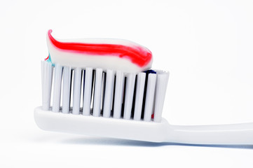 Toothpaste on the toothbrush. Closeup. Isolated on a white.