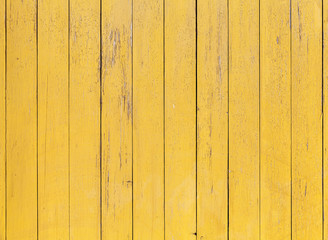 Fototapete - Old yellow wooden wall with cracked paint layer