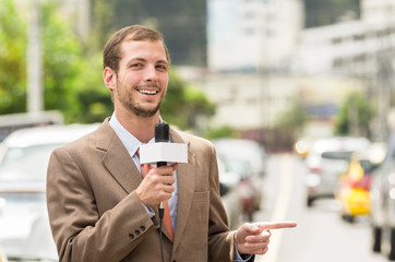 Successful attractive male journalist wearing brown suit working