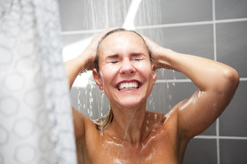 blond woman taking a shower