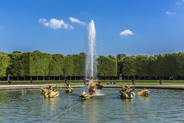 Dragon fountain in gardens of Versailles palace. Paris, France.