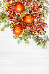 three orange Xmas balls and twig on blank paper