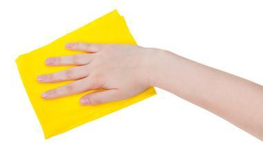hand with yellow cleaning rag isolated on white