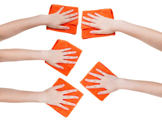 set of hands with orange microfibre rags isolated