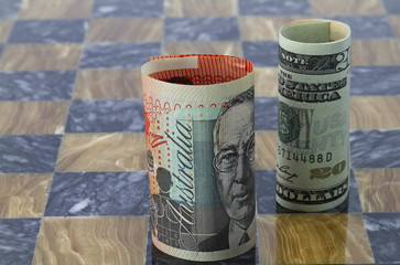 Australian and American dollars stand on game board