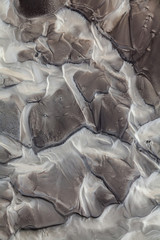 Abstract patterns made by water flowing over a volcanic valley in the interior of Iceland.