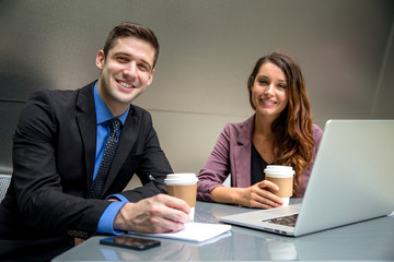 Man and woman executive business environment on computer laptop with coffee finance attorneys