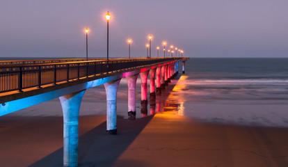 Decorative lighting of a pier at twilight