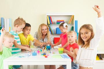 Preschoolers with teacher