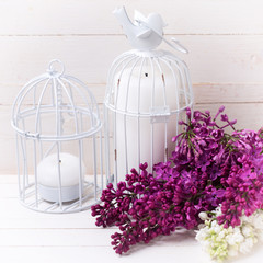 Lilac  and candles on wooden background.