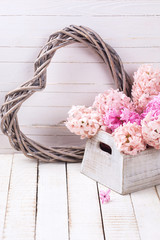 Background with fresh flowers hyacinths and decorative heart