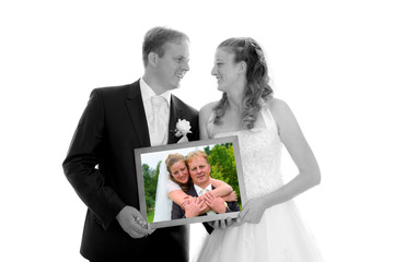 bridal couple with photo of themselves