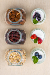 healthy breakfast with yogurt, berry and nuts, dieting