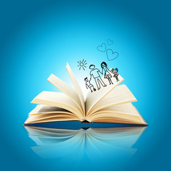 Open book with drawings on blue background